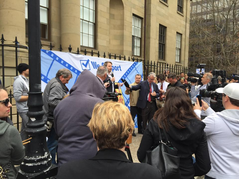 Almon speaking outside of Province House in May, 2015.