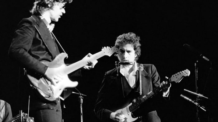 Bob Dylan performs with Robbie Robertson of The Band at Madison Square Garden as part of his 1974 Tour Of America on January 30th, 1974 in New York City. Gijsbert Hanekroot/Redferns/Getty